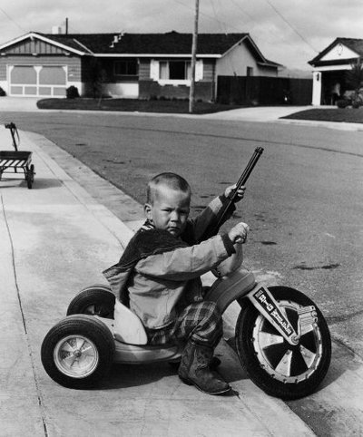 2kid with big wheel and rifle via figout
