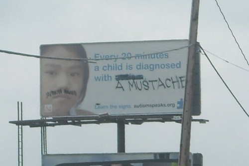 Moustache billboard hack via theinternetaccordingtoadrian