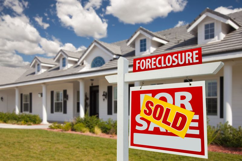 Sold-foreclosure-real-estate-sign-and-house-right